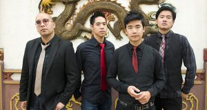 """This photo provided by Anthony Pidgeon, taken Aug. 21, 2015, shows the Asian-American band The Slants, from left, Joe X Jiang, Ken Shima, Tyler Chen, Simon """"Young"""" Tam, Joe X Jiang in Old Town Chinatown, Portland, Ore. The Supreme Court could decide as early as this month whether to hear the dispute involving the Portland, Oregon-area band. And if the Washington Redskins football team has its way, the justices could hear both cases in its new term.  (Anthony Pidgeon/Redferns via AP)"""