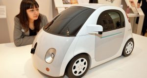 "Google driverless cars. File photo dated 24/3/2015 of a woman studies the Google driverless car model. Transport bosses in London are in ""active discussions"" with Google in a bid to bring trials of its driverless cars to the UK. Issue date: Saturday February 6, 2016. Deputy mayor for transport Isabel Dedring said officials met with the technology giant recently to encourage it to extend its pilot scheme to the capital. It would be the first time Google's autonomous cars have been tested extensively outside of the US. See PA story TRANSPORT Driverless. Photo credit should read: John Stillwell/PA Wire URN:25445368"