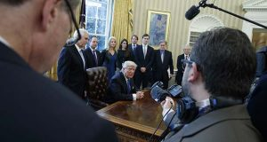 President Donald Trump answers a question about the Supreme Court after signing a series of executive orders,Tuesday, Jan. 24, 2017,  in the Oval Office of the White House in Washington. (AP Photo/Evan Vucci)