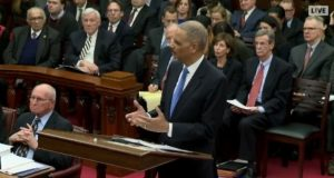 Former U.S. Attorney General Eric Holder addresses the Court of Appeals on Thursday as the top court considered bail reform. (Maryland Judiciary)
