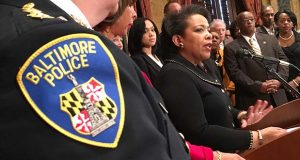 """Attorney General Loretta Lynch speaks Thursday at a news conference announcing the settlement and consent decree between Baltimore and the Department of Justice. Lynch called Baltimore """"a city of passionate and determined people"""" and asks for passion to be brought to the process. (The Daily Record / Maximilian Franz)"""
