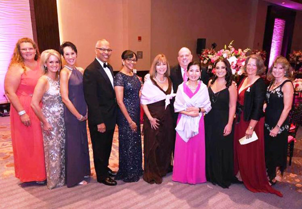 From left, Jodie Gray, Claudia Boldyga, Christina Cugle, Lt. Gov. Boyd Rutherford, Monica Rutherford, Bosom Buddies co-founder and Coldwell Banker Agent Biana Arentz, Gov. Larry Hogan, first lady Yumi Hogan, Elizabeth DeCesaris, Lynne Kinney and Karen White, all members of the Bosom Buddies board of directors, attended the organization's annual ball in Annapolis to promote breast cancer awareness. (Photo by Joe Andrucyk)