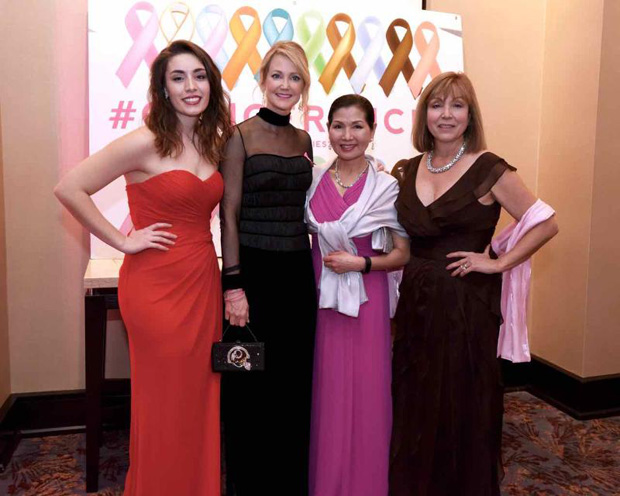 From left, Elizabeth Arentz, Tanya Snyder, Maryland first lady Yumi Hogan and Bosom Buddies co-founder and Coldwell Banker Agent Biana Arentz are all dressed up for the Bosom Buddies Ball to support breast cancer awareness. (Photo by Joe Andrucyk)