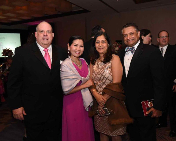 Maryland Gov. Larry Hogan, far left, and first lady Yumi Hogan enjoy their time at the Bosom Buddies Ball with Bina and Sam Malhotra, the governor's chief of staff. (Photo by Joe Andrucyk)