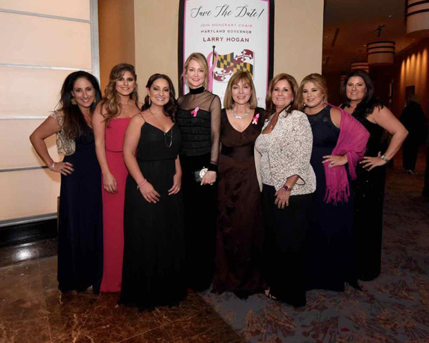 From left, JoAnn DeCesaris Wellington, Maria DeCesaris Capurro, Elizabeth DeCesaris, Ball honoree Tanya Snyder, Bosom Buddies co-founder and Coldwell Banker Agent Biana Arentz, JoAnn DeCesaris, Kristen DeCesaris Messineo and Angela DeCesaris Duffy are all smiles during the 10th annual Bosom Buddies Ball at the Annapolis Westin hotel. (Photo by Joe Andrucyk)