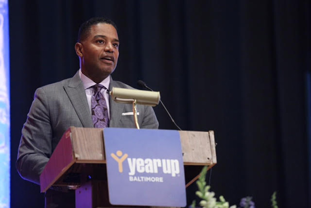 Calvin G. Butler Jr., the CEO of Baltimore Gas & Electric and a Year Up corporate partner, gives the keynote address to Cohort 11 during the Year Up Baltimore graduation ceremony. (Photo by Jason Putsche Photography)