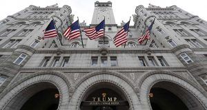 FILE - In this Dec. 21, 2016 file photo, the Trump International Hotel in Washington. An electrical subcontractor who worked on the Trump International Hotel in Washington has sued a company owned by President Donald Trump for more than $2 million, alleging it was not fully paid. (AP Photo/Alex Brandon, File)
