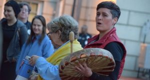 Former Del. Heather Mizeur leads a crowd of about 50 in a Native American chant. The flash mob-style protest called on Gov. Larry Hogan to speak out against the Dakota Access Pipeline Proejct. (The Daily Record / Bryan P. Sears)