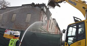 Project C.O.R.E. demolition crews start knocking down the rowhomes on the 1700 block of N. Chester Street in East Baltimore.(The Daily Record / Maximilian Franz)
