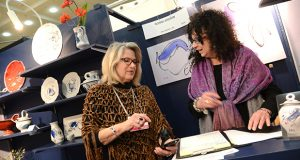 2.23.17 BALTIMORE, MD- From Left, artist Nancy Thomas, Owner of The Artists' Gallery in Chestertown, MD visiting the booth of Ronni Aronin,  co-founder and resident  porcelain artist rtist at the Baltimore Clayworks. Photos taking at the 2017 American Craft Council Show at the Baltimore Convention Center. (The Daily Record/ Maximilian Franz)