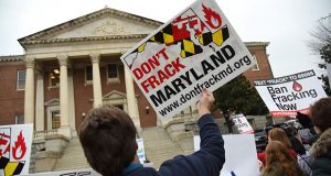 A protester holds a sign opposing hydraulic fracturing in Maryland.(File)