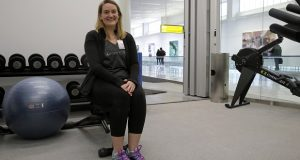 In this Jan. 30, 2017 photo, ROAM Fitness CEO Cynthia Sandall poses inside the soon-to-be-open ROAM Fitness gym at Baltimore-Washington International Thurgood Marshall Airport in Linthicum, Md. Working out while waiting for your flight will soon be an option at BWI, where the only gym at a U.S. airport past security will open this week, with plans for 20 more at airports by 2020.  (AP Photo/Patrick Semansky)