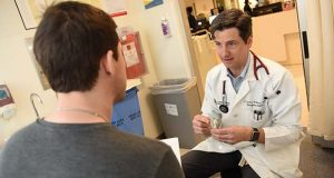 Dr. Gentry Wilkerson, an emergency medicine physician at the University of Maryland Medical Center, is hopeful that training opioid users and their families on administering the antidote naloxone will reduce fatal overdoses and even encourage users to seek long-term treatment. (The Daily Record / Maximilian Franz)