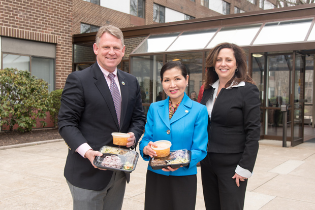 Showing the Korean meals to be delivered are from left, Howard County Executive Allan Kittleman, first lady Yumi Hogan and Meals on Wheels Executive Director Stephanie Archer-Smith. (Photo by Donovan Eaton)