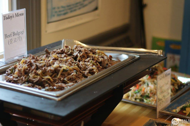 Bulgogi was the main course of the meals delivered Tuesday; it was also served in the buffet marking the start of the deliveries. (Photo by Courtney Trusty)