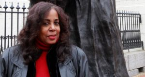 """Lynne Jackson, the great-granddaughter of Dred and Harriet Scott, photographed at the Old Courthouse in downtown St. Louis in front of a statue of her ancestors. Jackson, founder and president of the Dred Scott Foundation, gives talks across the country about her ancestors' case. 'I just felt like I should know more than the average person,' she said. 'I think God was telling me, """"You need to study this,"""" and it made a lot of sense to me.' (Missouri Lawyers Media)"""