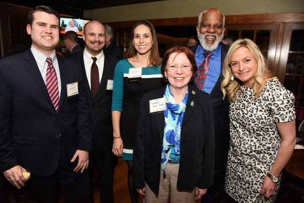 From left, Josh Howe, a legislative aide; Tyler Bennett, a government relations consultant; and Camille Fesche, an attorney and government relations consultant, all with the firm Alexander & Cleaver; Del. Anne Healey, D-Prince George's County; Wilhelm H. Joseph, the executive director of Maryland Legal Aid; and Hannah Garagiola, the director of government relations with Alexander & Cleaver, attended The Daily Record's Eye on Annapolis Happy Hour event. (Photo by Maximilian Franz / The Daily Record)