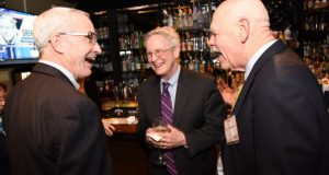 From left, Patrick J. Hogan, of Cornerstone Government Affairs; Tom Lewis, the operations manager with the Maryland Department of Health and Mental Hygiene; and Del. Robert L. Flanagan, R-Howard County, share a laugh during The Daily Record's Eye on Annapolis Happy Hour event. (Photo by Maximilian Franz / The Daily Record)
