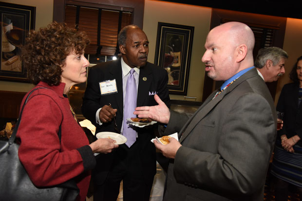 Del. Shelly Hettleman, D-Baltimore County, left, and Del. Benjamin T. Brooks, D-Baltimore County strike up a conversation with The Daily Record's government affairs writer Bryan P. Sears, right, during The Daily Record's Eye on Annapolis Happy Hour event. (Photo by Maximilian Franz / The Daily Record)