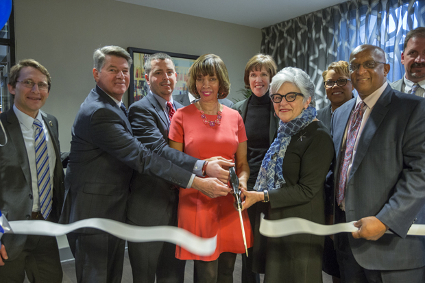 Baltimore city and community leaders, including Mayor Catherine Pugh, center, were present for the ribbon cutting and grand opening of Mulberry at Park Apartments. (Photo by Alan Gilbert)