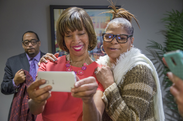 Baltimore Mayor Catherine Pugh, left, chats with Yvonne Burrell, a resident at Mulberry at Park Apartments. (Photo by Alan Gilbert)