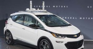 In this photo provided by General Motors a self-driving car is seen in Detroit. General Motors is trying to persuade state lawmakers across the country to pass legislation that would clear the way for the automaker to make self-driving cars publicly available while potentially barring GM's competitors from putting their own vehicles on the road.  (Photo by Steve Fecht for General Motors)