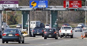 FILE- In this April 21, 2011, file photo, cars pass through the toll booths at the Garden State Parkway's Asbury toll plaza near Tinton Falls, N.J. Although the average drive grudgingly pays tolls for highways, bridges and tunnels, some go to great lengths to beat those tolls. Many of those drivers have racked up thousands of dollars in unpaid tolls and related fees that can lead to theft and other criminal charges. (AP Photo/Mel Evans, File)