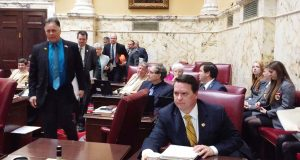 Republican Senators walk off the floor in protest on Thursday over a resolution that would allow the Office of the Attorney General to sue the federal government without the governor's permission. (The Daily Record / Bryan P. Sears)