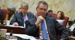 """Sen. Thomas M. """"Mac"""" Middleton, D-Charles and Chair of the Senate Finance Committee, sits down at the end of a re-opened debate on mandatory paid sick leave."""