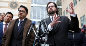 Justin B. Cox, right, of the National Immigration Law Center, representing all the plaintiffs, with Omar C. Jadwat of the American Civil Liberties Union, speaks to reporters outside U.S. District Court in Greenbelt on Wednesday after a federal judge heard their argument challenging President Donald Trump's revised travel ban. (Manuel Balce Ceneta/AP Photo)