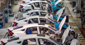 Workers assemble Honda Civic cars at Dongfeng Honda Automobile assembly plant in central China last month. Honda and other automakers have argued that Obama-era rules on fuel-economy standards impose higher costs and carry risk for American workers. (Chinatopix via AP)