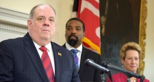 Gov. Larry Hogan, joined by Pastor Michael Phillips of Kingdom Life Church in Baltimore and State Superintendent of Schools Karen B. Salmon on Friday in Annapolis, says a proposed education bill, if adopted, would leave Maryland with the 'weakest education accountability system in the United States of America.'  (Bryan P. Sears/The Daily Record)