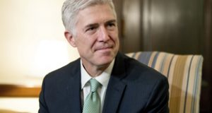 Supreme Court Justice nominee Neil Gorsuch meets with Sen. Chris Coons, D-Del. on Capitol Hill Feb. 14 in Washington. (AP Photo/Andrew Harnik, File)