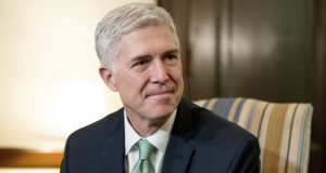 "FILE - In this Feb. 14, 2017, file photo, Supreme Court Justice nominee Neil Gorsuch meets with Sen. Chris Coons, D-Del. on Capitol Hill in Washington. Gorsuch is roundly described by colleagues and friends as a silver-haired combination of wicked smarts, down-to-earth modesty, disarming warmth and careful deliberation. His critics largely agree with that view of the self-described ""workaday judge"" in polyester robes. Even so, they're not sure it's enough to warrant giving him a spot on the court. (AP Photo/Andrew Harnik, File)"
