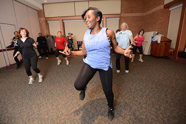 Staying healthy is very important to Lakeisha Taharka, a nuclear medicine technician at the Maryland-based Anne Arundel Medical Center, who teaches Zumba once a week as part of the hospital's employee wellness program. (The Daily Record/ Maximilian Franz)