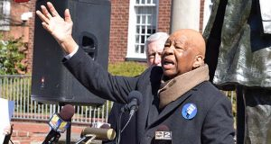 Rep. Elijah Cummings gestures at Government House, the official residence of Gov. Larry Hogan, as he calls on the first-term Republican to call on Congress to protect nearly 400,000 Maryland residents projected to lose health care under an effort to repeal and replace of the Affordable Care Act. (The Daily Record / Bryan P. Sears)