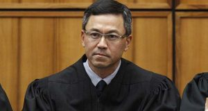 This December 2015 photo shows U.S. District Judge Derrick Watson in Honolulu. (George Lee/The Star-Advertiser via AP)