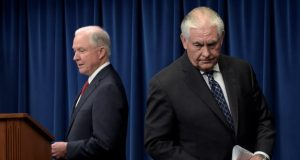 Attorney General Jeff Sessions, left, takes his turn to make a statement following Secretary of State Rex Tillerson, on issues related to visas and travel, Monday, March 6, 2017, at the U.S. Customs and Border Protection office in Washington. (AP Photo/Susan Walsh)