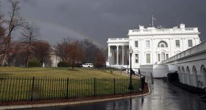 FILE - In this Saturday, Feb. 25, 2017, file photo, a rainbow is seen next to the White House as a cold front passes through the area in Washington. The White House is staffing up its team of lawyers as it prepares for a complicated mix of ethics issues and policy fights ahead. (AP Photo/Alex Brandon, File)