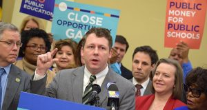 """Del. Eric G. Luedtke, D-Montgomery, speaks Thursday morning at a rally urging lawmakers override Gov. Larry Hogan's veto of the """"Protect our Schools Act."""" The House of Delegates and Senate did just that hours later.  (Bryan P. Sears/The Daily Record)"""