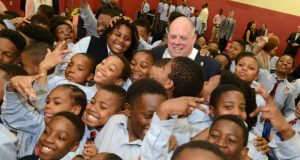 Governor Larry Hogan poses for photos with a group of students from the Baltimore Collegiate School for Boys in the charter school's auditorium Wednesday afternoon. Hogan came to the city to announce his veto of the 'Protect our Schools Act.' (Maximilian Franz/The Daily Record)