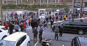 Spectators and drone pilots gathered in Baltimore on April 1, 2017, to watch the first Drone Grand Prix, a race specifically for drones.  The drones flew through a netted-off course in the closed street, navigating around gates and barriers. (Hannah Klarner/ Capital News Service)