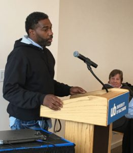 Malcolm Bryant addresses the audience at a UB School of Law symposium on wrongful convictions on Sept. 29, 2016. Professor Michele Nethercott, director of UB's Innocence Project Clinic, is at right. (University of Baltimore School of Law)