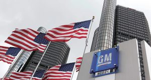 FILE - This April 21, 2009 file photo shows General Motors Co. world headquarters in Detroit. A confident General Motors has added 20 million shares of preferred stock to its initial public offering, and it raised the estimated price range for common shares by about 14 percent to $32 to $33.(AP Photo/Paul Sancya, file)