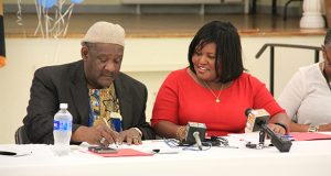 Michael Middleton, chairman of SB7, and Alicia Wilson, Sagamore Development Co.'s senior vice president for community affairs, sign an agreement creating the new SB7 community group. (The Daily Record / Adam Bednar)