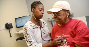 10-12-2016 BALTIMORE, MD- Dr. Samyra Sealy, Internal Medicine, examines Baltimore resident Greta Houston, at Mercy Medical Center.  (The Daily Record/ Maximilian Franz).
