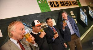 5.23.17 BALTIMORE, MD- From Left, Comptroller Peter Franchot; Secretary of Agriculture, Joseph Bartenfelder; Benjamin H. Wu, Deputy Secretary of Commerce; and Kevin Atticks, Executive Director of the Maryland Winery Association and the Brewery Association of Maryland, seen here drinking some Old Oriole Park Bohemian Beer at Peabody Heights Brewery after unveiling The Official Maryland Baseball & Brew Scorecard.  (Maximilian Franz/The Daily Record)