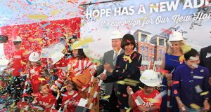 Confetti falls at the groundbreaking of the new Ronald McDonald House in the Jonestown neighborhood. (The Daily Record / Adam Bednar)