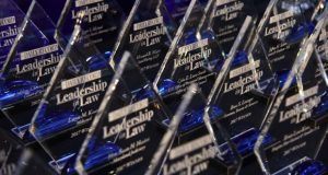 Lineup of Leadership in Law Awards on the table before the event. (The Daily Record / Maximilian Franz)