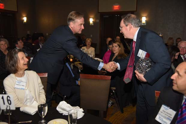 Leadership in Law winner Joseph S. Michael shaking the had of the Honorable Christopher B. Kehoe after accepting his Top Winner Award. (The Daily Record / Maximilian Franz)